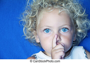 it\'s a surprise - a young caucasian child with blue eyes...