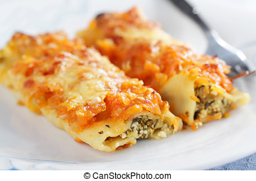 Cannelloni with ricotta cheese and spinach under tomato...