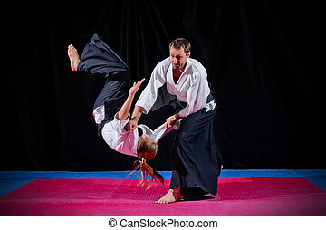 Two martial arts fighters on black