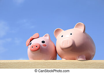 Pink piggy bank couple with blue sky, great for business and...