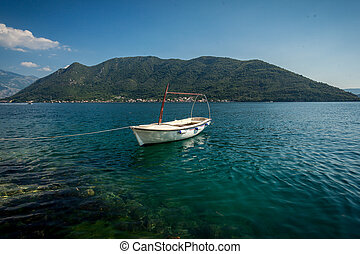 Kotor bay with moored white wooden rowboat - Beautiful view...