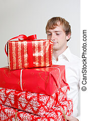 Presenting alot of gifts - A man presenting several...