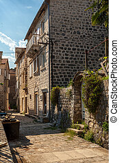 narrow street of ancient city Perast, Montenegro - Beautiful...