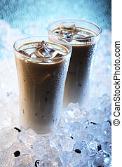 Iced Coffee - Two glasses with milk, coffee and icecubes