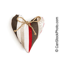 Decorative valentine heart of fabric with ribbon on a white...