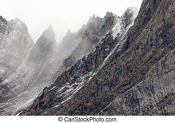 rugged mountains in the winter fog - rugged mountains in the...