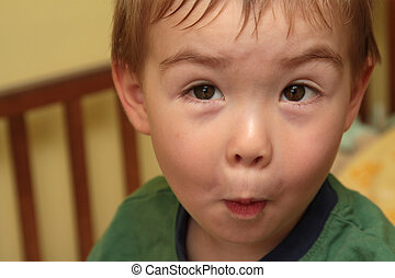 Funny Face - A young boy making a funny face
