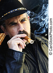 Bearded man smoking cigar - Man with beard in cowboy hat...
