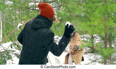 Winter Activity - Carefree couple enjoying their snowball...