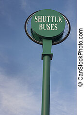shuttle buses sign against blue sky - bus stop sign with...