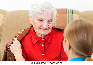 Elderly home care - Young carer wrap the elderly woman with...