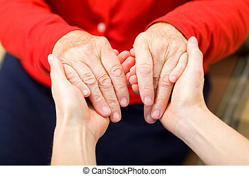 Helping hands - Young carer giving helping hands for elderly...
