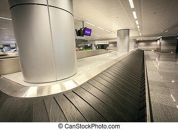 wide angle shot of empty luggage claim at airport terminal -...
