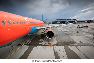 civilian airliner with jet engine on runway at storm - Big...