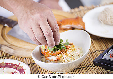 Close up hand of Chef cooking Noodle