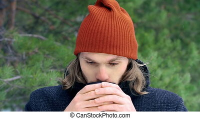 Gradually Thawing - Close up of young man drinking hot tea...