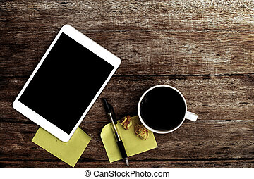 coffee and Tablet with blank notepad on old wooden table