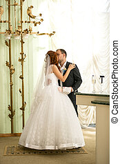 newly married couple kissing at registry office - Beautiful...
