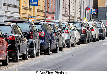 cars parked on the roadside, symbol for parking, mobility,...