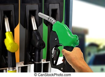 Holding Gas Nozzle at Gas Station - Hand Holding Gas Nozzle...