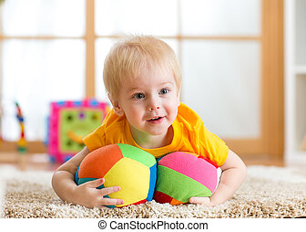 toddler boy playing with toys indoors at home