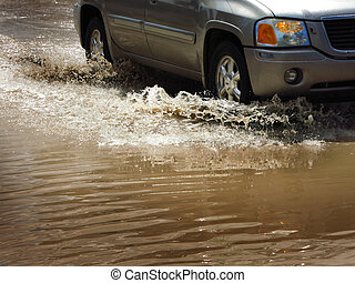 Car Driving Through Flood Waters