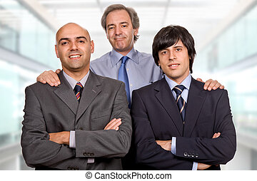 team - three business man at the office