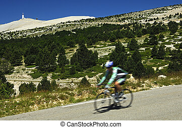 Cyclists on the down hill race from Mont Ventoux, peak in...