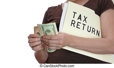 Tax Return Counting Money - Woman with a file folder tucked...