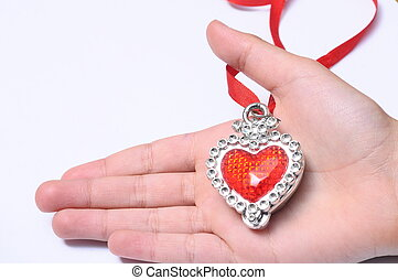 Red heart on hand - Close up or Red heart on hand