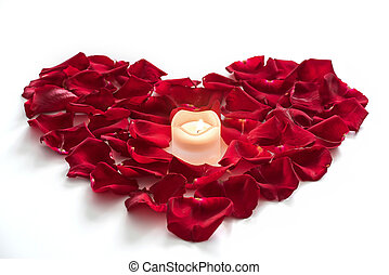 Rose petals in heart form with candle