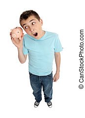 Surprised boy shaking money box - A pre teen boy shakes a...