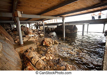 View from under the pier on shore and sea