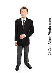 Secondary school student standing in uniform. White...