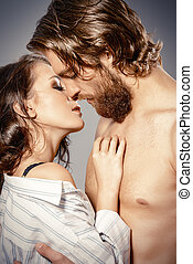 lovers kiss - Beautiful loving young people kissing....