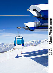 Cable car cabins on mountain peak