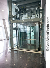 glass elevator for disabled people at international airport...