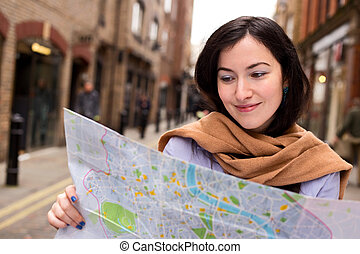young woman reading map