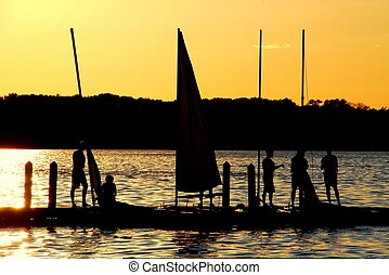 Lake Fun Silhouette - Sailors Enjoy the Sunset on Lake...