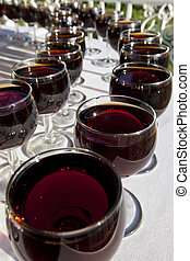 Wine Glasses - Rows of wineglasses filled with red wine