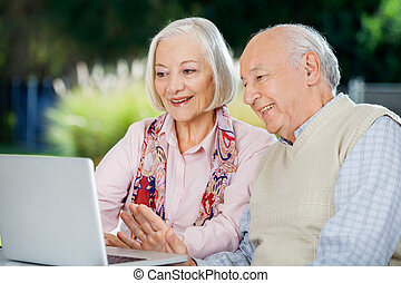 Senior Couple Video Chatting On Laptop - Senior couple video...