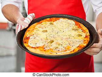 Chef Holding Delicious Pizza In Pan