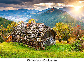 Sunset landscape with old rural house