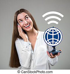 Roaming concept - Young and smiling woman talking by mobile...