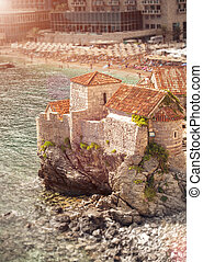 old castle standing on high cliff at sea at sunny day -...