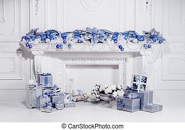 Christmas decorations and white fireplace. Sudio shot