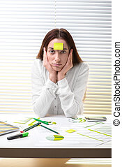 Economist working - Young tired woman economist working with...