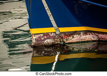 painted old boat prow at sea - Closeup photo of painted old...