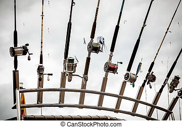 row of fishing rods on ship - Closeup photo of row of...