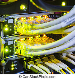 rack in the data center with working servers with optical...